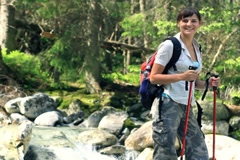 Stock Video Footage of Portrait of young beautiful hiker in the forest