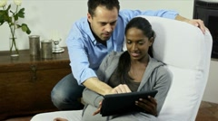 Woman and man using digital tablet pc at home Stock Footage