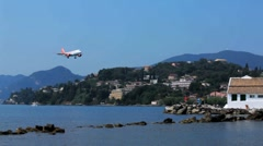 Landing of Easyjet airplane above Vlacherna monastery, Corfu airport, Greece Stock Footage