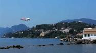 Landing of Easyjet airplane above Vlacherna monastery, Corfu airport, Greece Stock Footage