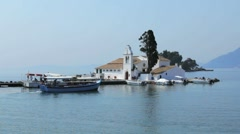 Tourist boats near Vlacherna monastery, Kanoni, Corfu, Greece Stock Footage
