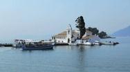 Tourist boats near Vlacherna monastery, Kanoni, Corfu, Greece Stock Footage