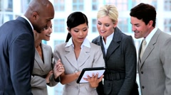 Multi Ethnic Business Team With Wireless Tablet Stock Footage
