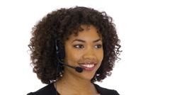 Customer service woman talking into headset - stock footage