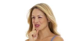 Woman shushing with finger on lips Stock Footage