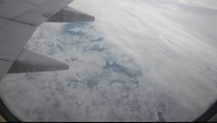 Flying over the sky with snow landscape in plane 2 Stock Footage