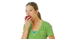 Woman eating a red apple Stock Footage
