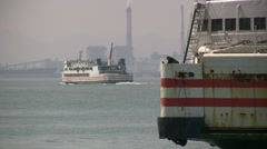Ferry arrives at dock in China - industry in the background Stock Footage