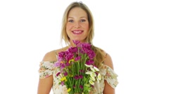 Portrait of a woman holding flowers Stock Footage