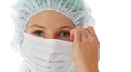 Close up of female surgeon wearing surgical mask Stock Footage