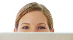Close up of surprised eyes over laptop Stock Footage