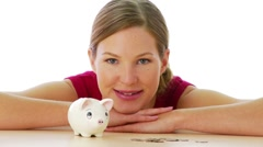 Portrait of woman with piggy bank - stock footage