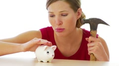 Woman preparing to break into her piggy bank Stock Footage