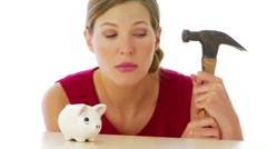 Woman preparing to break into her piggy bank - stock footage