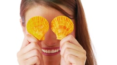 Woman playing peekaboo with sea shells Stock Footage