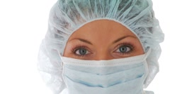 Close up of young woman wearing doctor mask and hair net Stock Footage