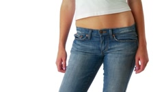 Young woman in blue jeans and white top showing stomach Stock Footage