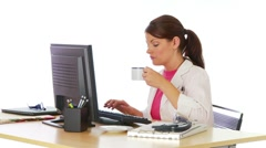 Young woman in labcoat working at desk - stock footage