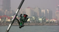 Fishing gear before skyline of Chinese city Qingdao Stock Footage