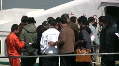 China, fast ferry, transportation, ticket check, passengers boarding, Chinese Stock Footage