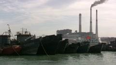 An old Chinese fishing fleet before smokestacks Stock Footage