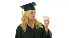 Young woman in graduation gown holding a hammer and piggy bank Stock Footage