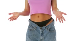 Woman showing off weight loss in baggy jeans Stock Footage