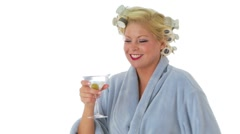 Woman with hair curlers and bathrobe with a martini Stock Footage