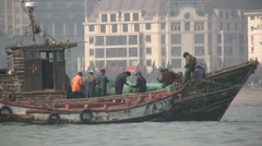 Chinese fishing boats and fishermen Stock Footage