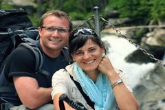 Portrait of happy hikers couple by the stream in the woods Stock Footage