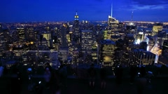 Tourists Enjoying New York City at night from a rooftop, Time Lapse Stock Footage