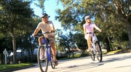 Fit & Healthy Retired Couple Cycling Together Stock Footage