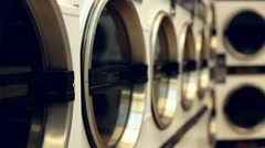 Dryers at the laundromat Stock Footage