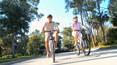 Senior Couple Keeping Fit by Cycling Stock Footage