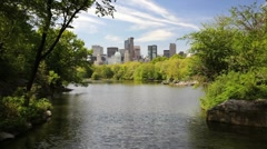 New York City Skyline Across Lake in Central Park Stock Footage
