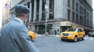Stock Video Footage of Yellow NYC Cabs in Wall Street