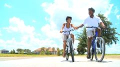 Young Healthy Ethnic Couple Cycling Together Stock Footage