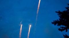 Fireworks at dusk. - stock footage