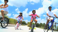 Healthy Lifestyle Cycling of Young Ethnic Family Stock Footage