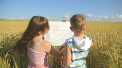 Young woman with little boy drawing landscape with crayons Stock Footage