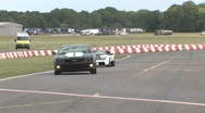 Stock Video Footage of Lamborghini and Camaro on track