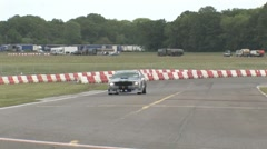 Mustang corners on race track Stock Footage
