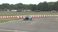 Stock Video Footage of Mustang corners on race track