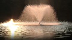 Fountain and Pond at Sunset Stock Footage