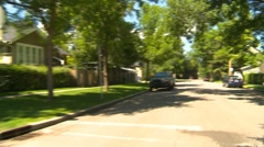 Drive plate, summer afternoon city, #11 shady street Stock Footage