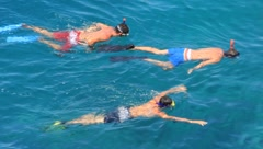 Three snorkelers on a blue sea Stock Footage