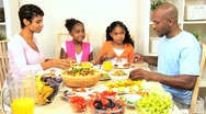 Stock Video Footage of Young Ethnic Family Healthy Lunch