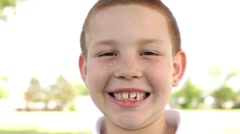 Young boy looking at camera smiling big Stock Footage