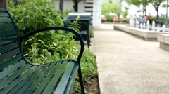 Empty park bench in park Stock Footage