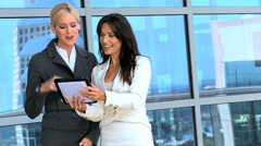 Meeting of Two Businesswomen Using Wireless Tablet Stock Footage